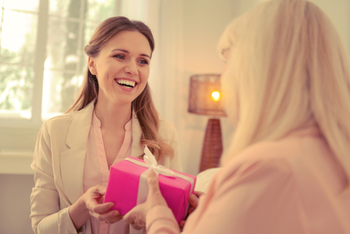 Giving a gift by Dmytro Zinkevych shutterstock_1242901645