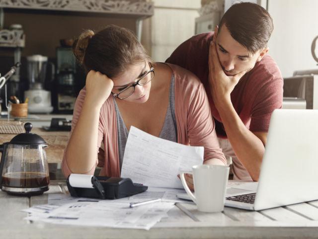 Managing your debt by WAYHOME studio shutterstock_556308208