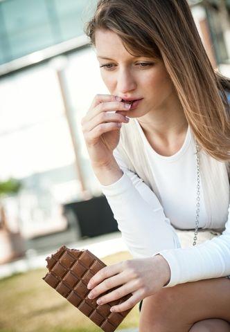 eating chocolate by Martin Novak shutterstock_115037230