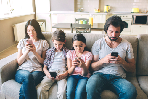 family on the phone by Estrada Anton shutterstock_1151186840