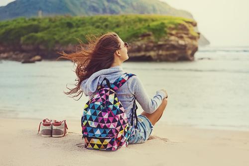 single female traveller by Mila Supinskaya Glashchenko shutterstock_248425678
