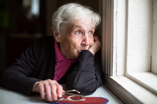 lonely old lady by De Visu shutterstock_521175373