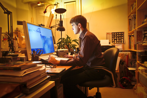 man working from home by Ollyy shutterstock_85837603