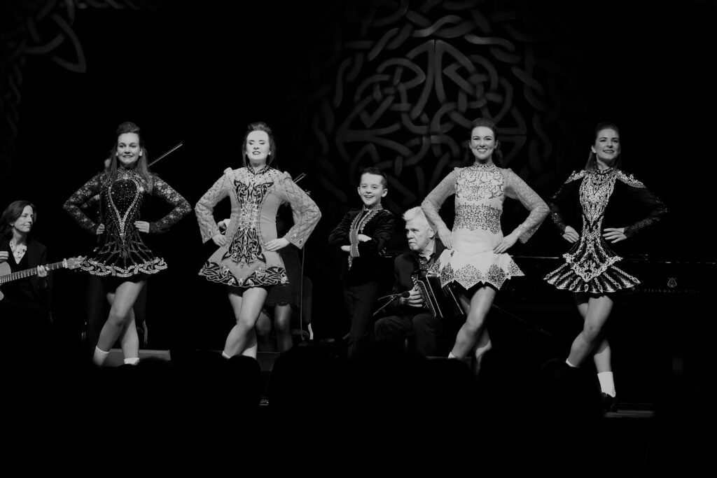 Dancers from Kristin Butke Irish Dance performing with Cherish the Ladies at Wolf Trap.