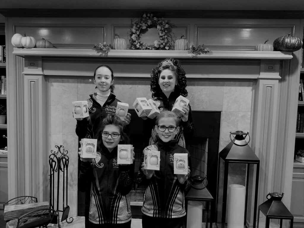 Dancers showing off their awards at the holiday feis in December 2019.