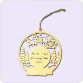 gold Christmas ornament with tree design