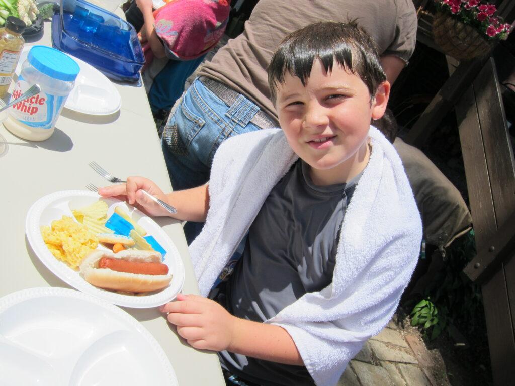 son's friend enjoying blue firm jello