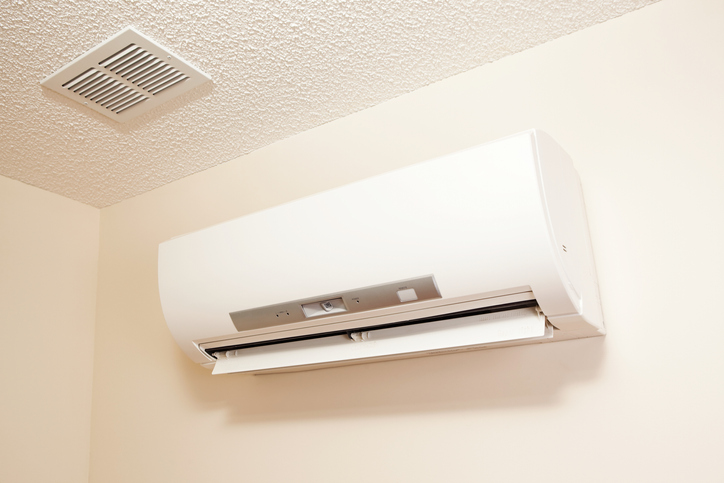 New ductless HVAC system mounted on wall offers all-in-one heating and cooling.