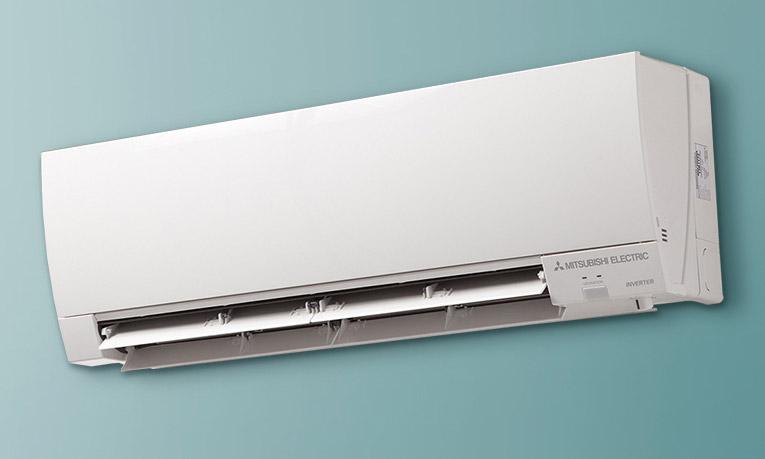 Mitsubishi Electric ductless AC mini split mounted to wall