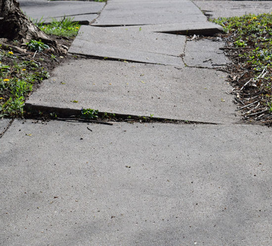 Broken sidewalk badly in need of maintenance