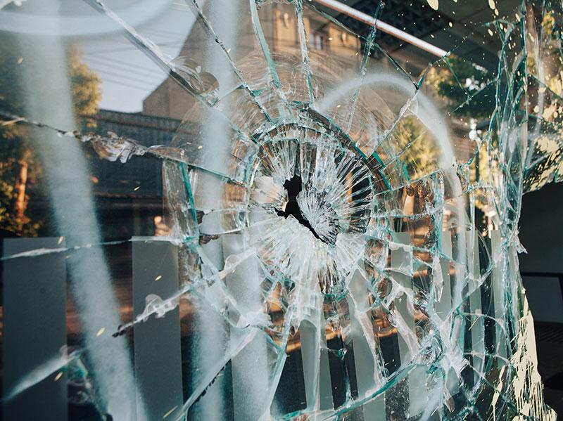 Smashed window showing property damage