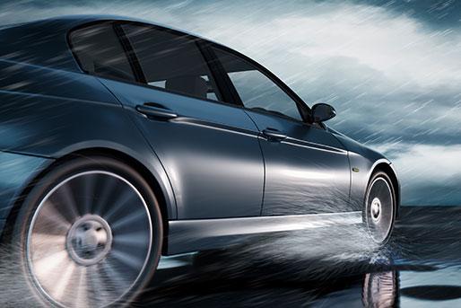 Luxury vehicle driving through water