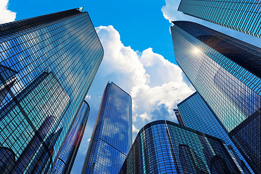 Modern skyline with tall buildings filled with offices