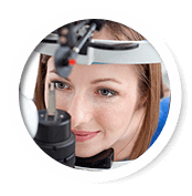 Younger Woman Getting an Eye Exam Performed on Her