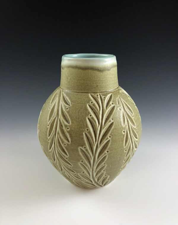 Carved porcelain vase by Dyann Myers. Wheel-thrown with matte green glaze.