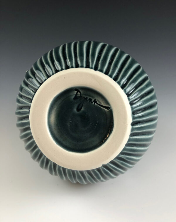 Carved porcelain vase by Dyann Myers. Wheel-thrown with glossy blue glaze.