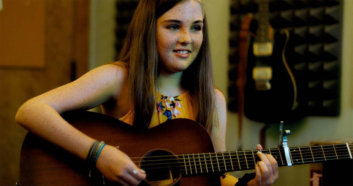 Emma playing guitar