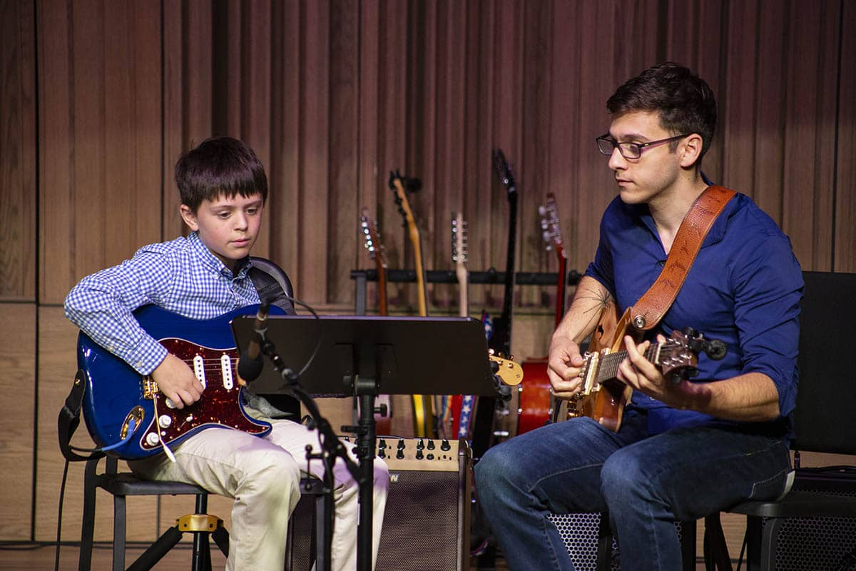 A Stages' student performs with his instructor.