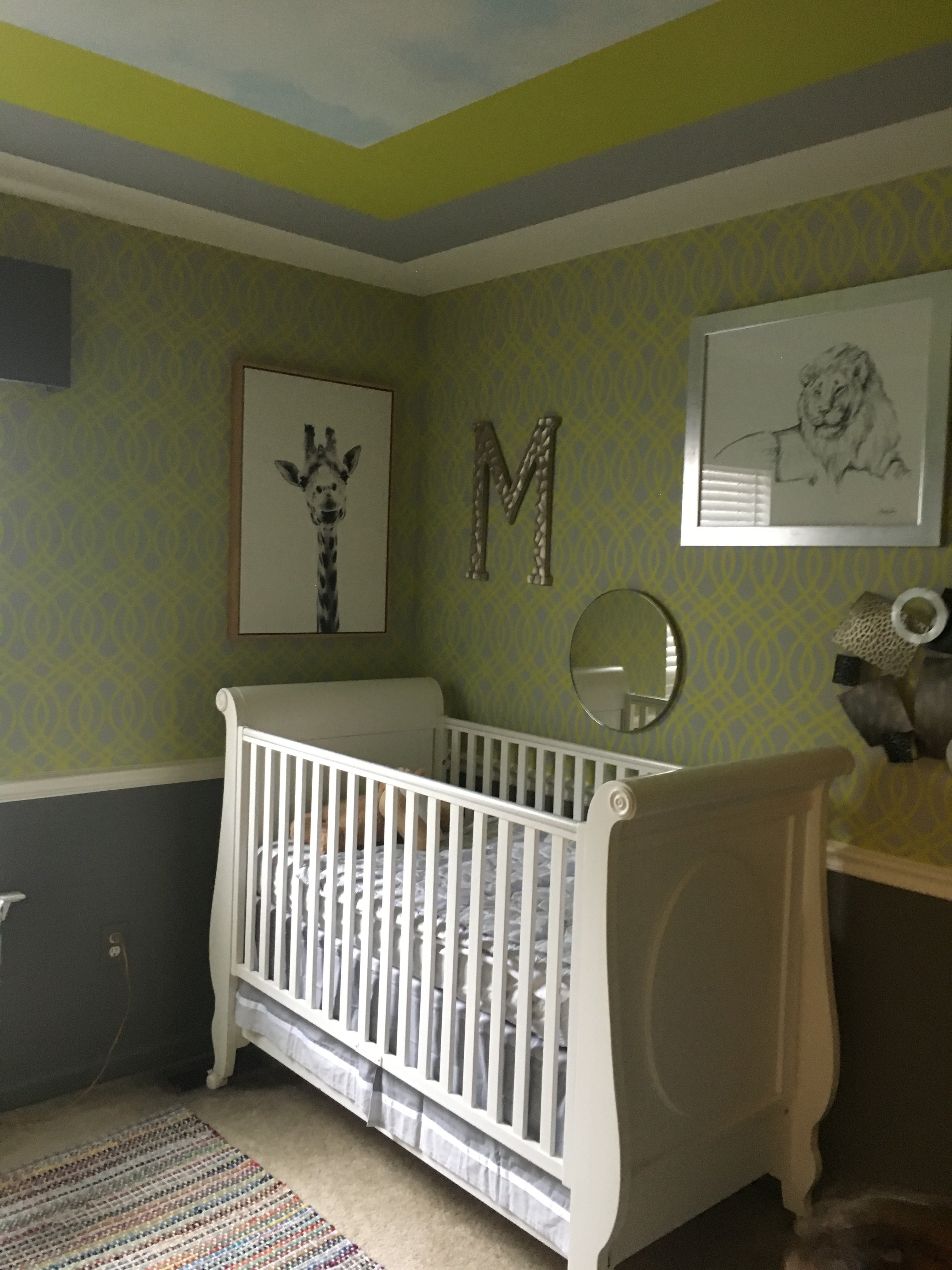 Miles bedroom is stenciled in a gray and chartreuse pattern.