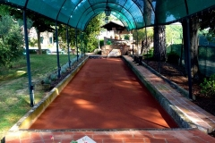 Covered and lighted clay bocce court