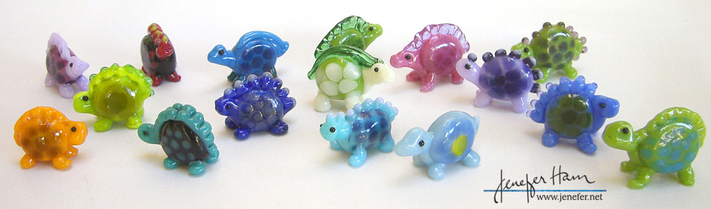 Glass dinosaur figurine miniatures made by Jenefer Ham