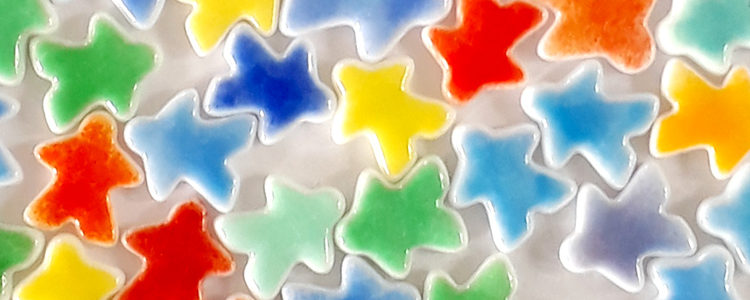 rainbows of tinted meeples by Jenefer Ham