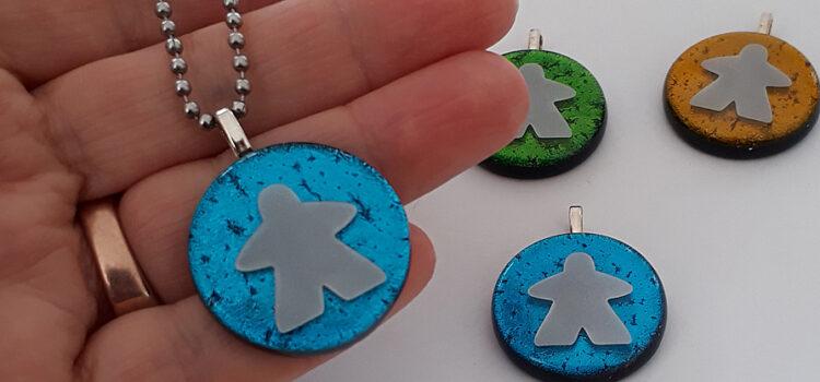 dichroic meeple pendants by Jenefer Ham