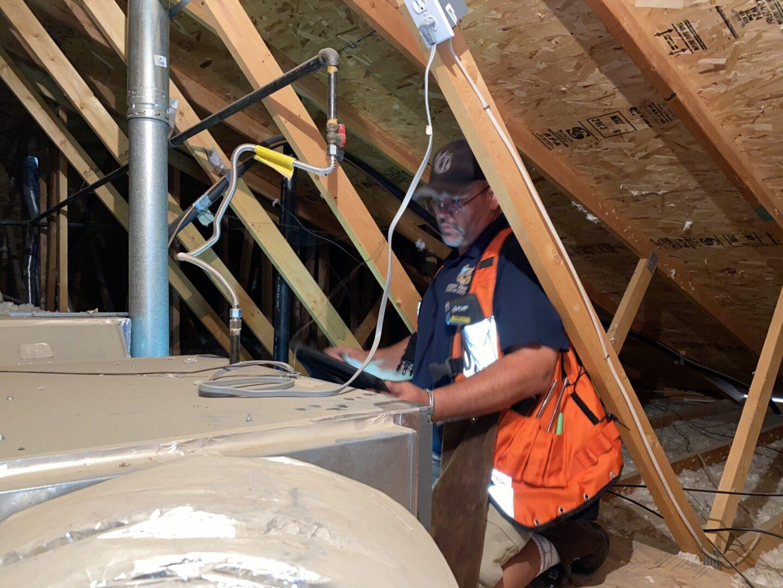 Inspector in attic