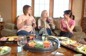 Three women enjoying drinks and snacks before getting a therapeutic massage at Coventina Day Spa in Waterford, PA