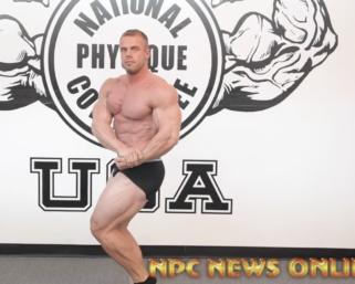 NPC Men's Bodybuilder Eric Wood runs through his posing routine at the NPC Photo Gym
