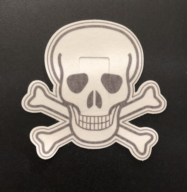 Skull Designed precut adhesive patch to secure all diabetic devices