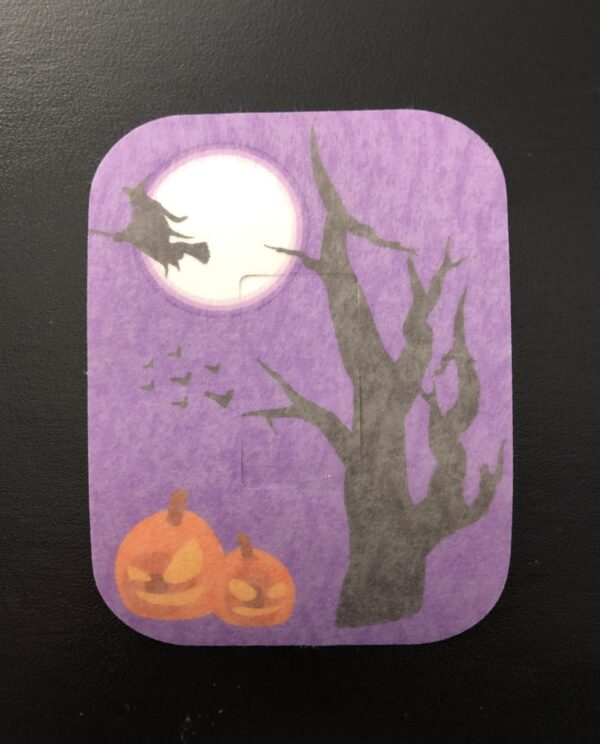 Halloween Flying Witch Designed precut adhesive patch to secure all diabetic devices