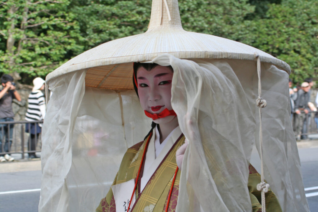 Woman in ichime gasa with mushi no tareginu. (A rush hat with a very large brim circumference that has sheer curtains and decorative cords hanging from it.)  at the Jidai Matsuri 2009