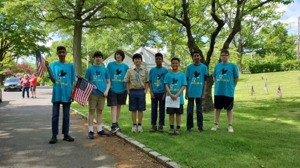 Troop 12 planting flags at local cemeteries on Memorial Day