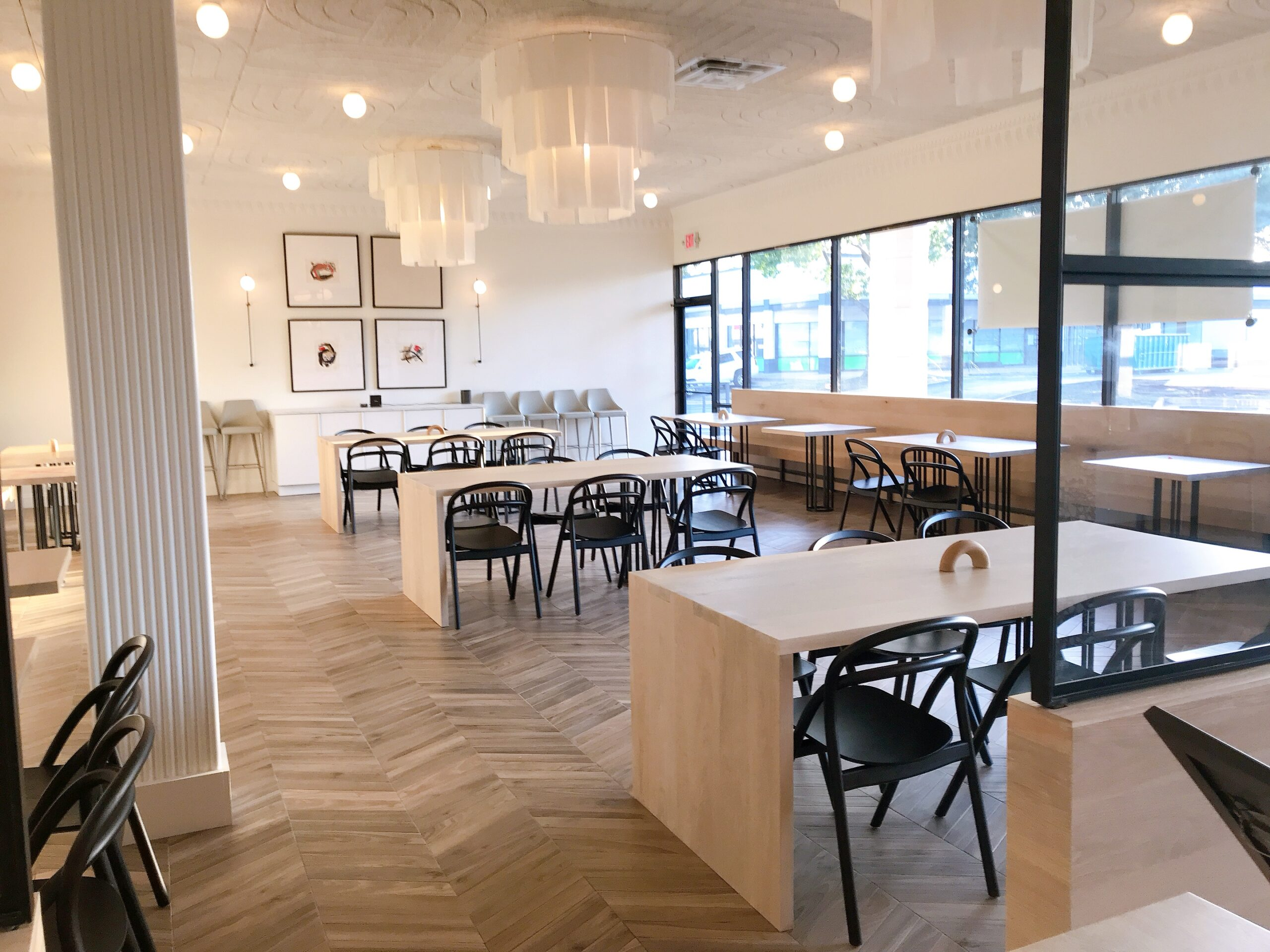 """  """"The skill behind ramen is a practiced art and I wanted the interiors to reflect the craft that goes into the creation of a perfect bowl. The aesthetic of the space takes Japanese modern interiors with a nod to Scandinavian hygge and French architecture to create an inviting space. An aside cocktail bar gives the space intimacy and a comfortable area for diners to relax before being seated.""""                                           -Matt Tsang, Lead Designer & Interior Visionary"""