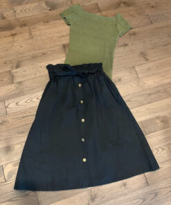 Paperbag Button Skirt shown in black and paired with a green top from Bright-Eyed & Beautiful Fashion Boutique
