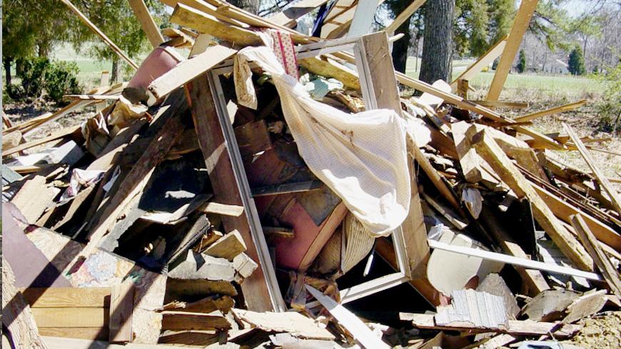 Demolition of a House Rubble Dumpster