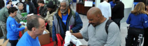 giving clothes to the homeless