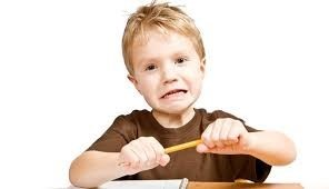 A child looking frustrated and snapping a pencil