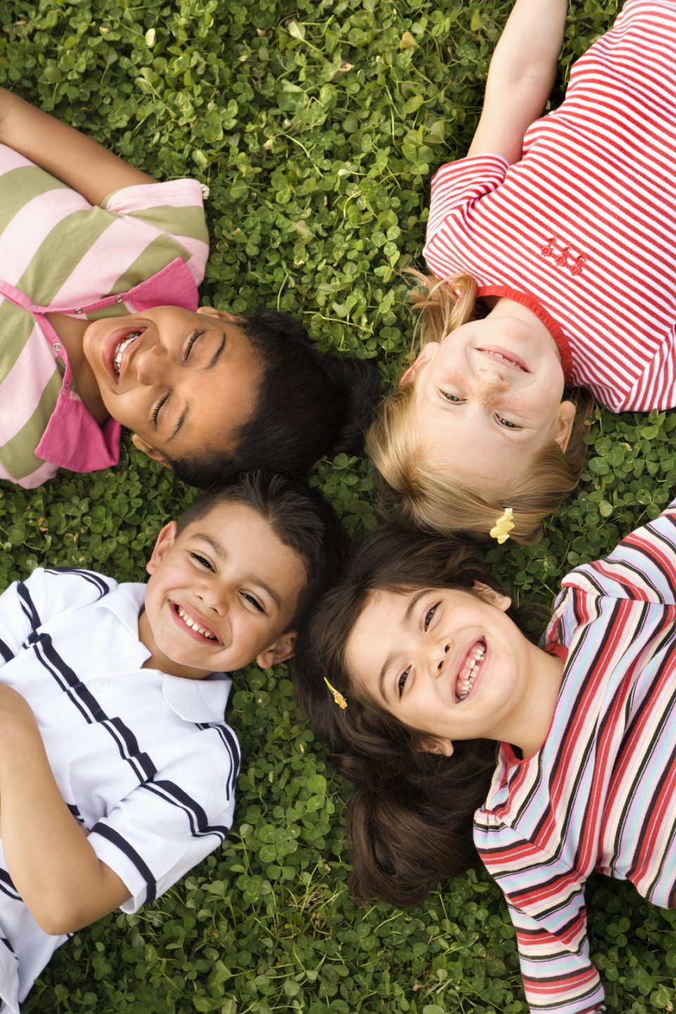 Children lying in a circle