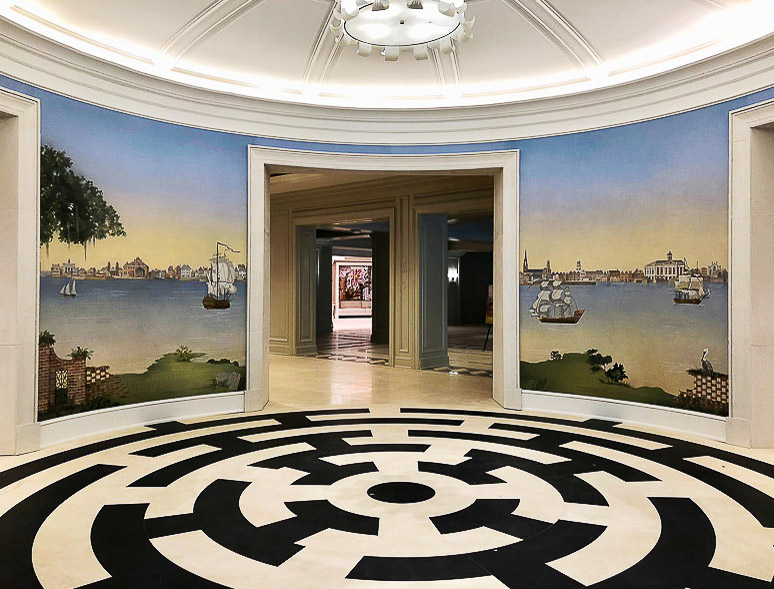 Low country mural installed in hotel rotunda walls with striking black and white flooring