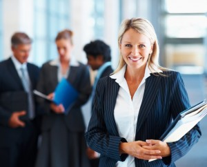 businesswoman with colleagues in background