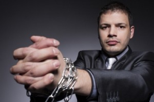 businessman in chains