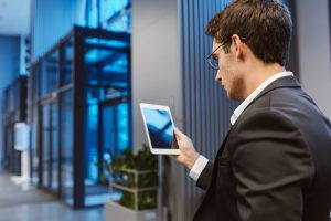 businessman reading tablet
