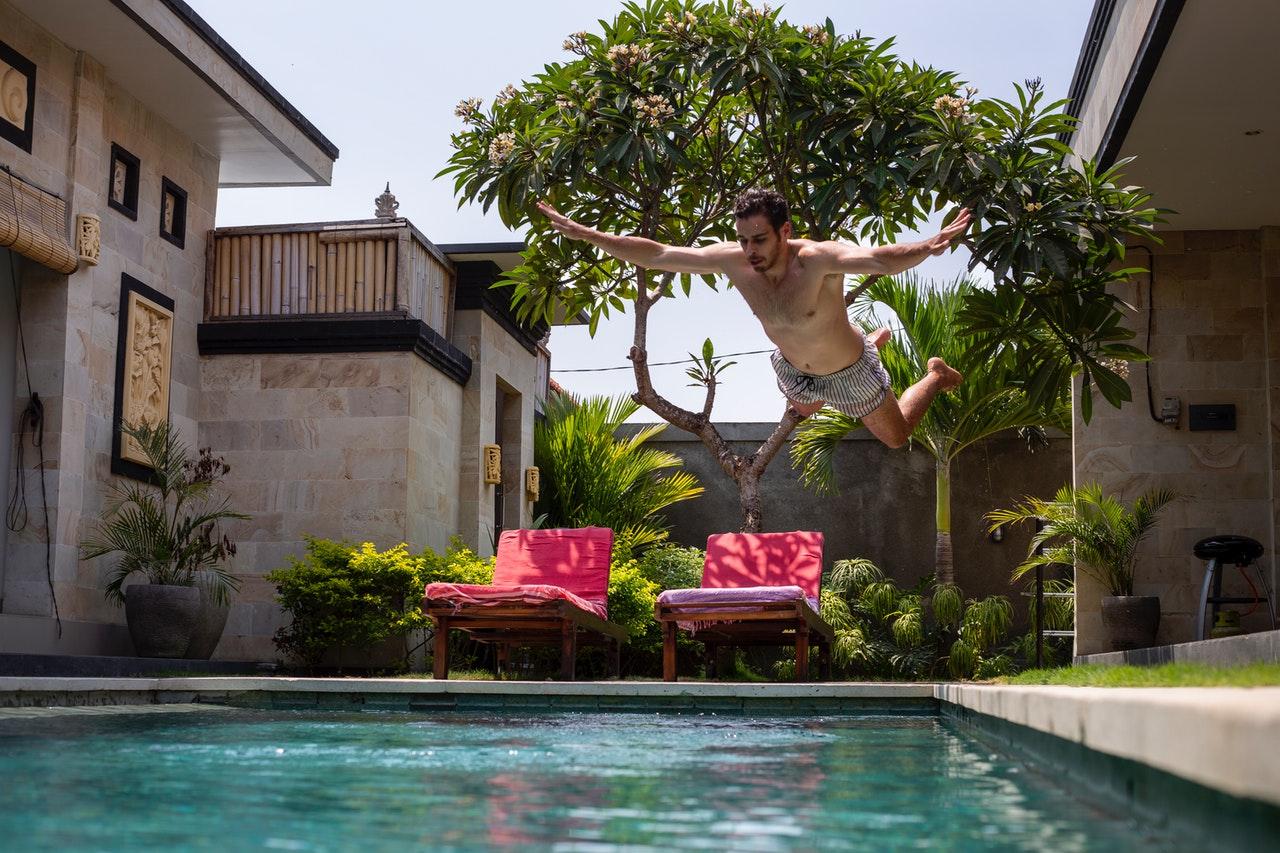 man-jumping-on-pool-3280801
