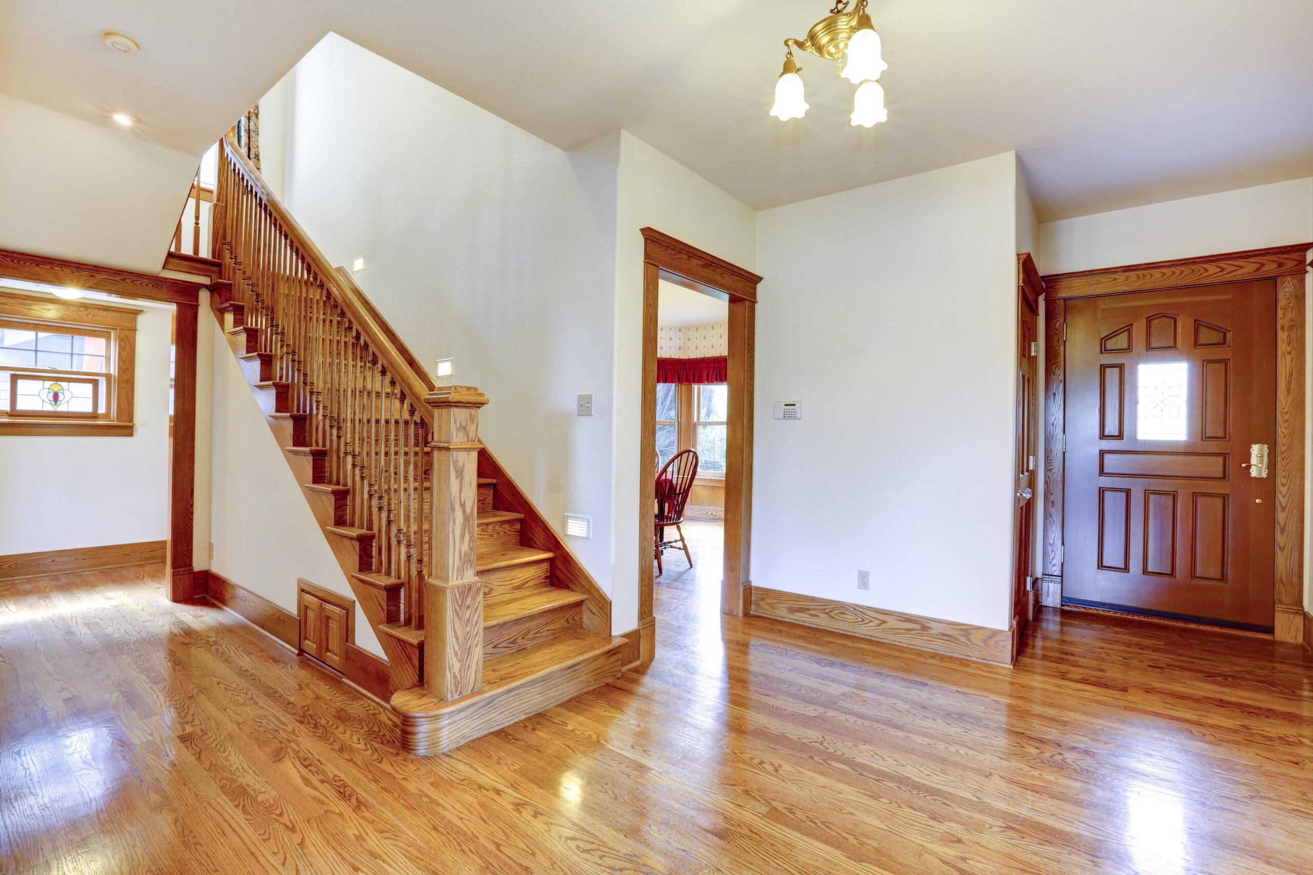 Empty,House,Interior.,Entrance,Hallway,With,New,Shiny,Hardwood,Floor