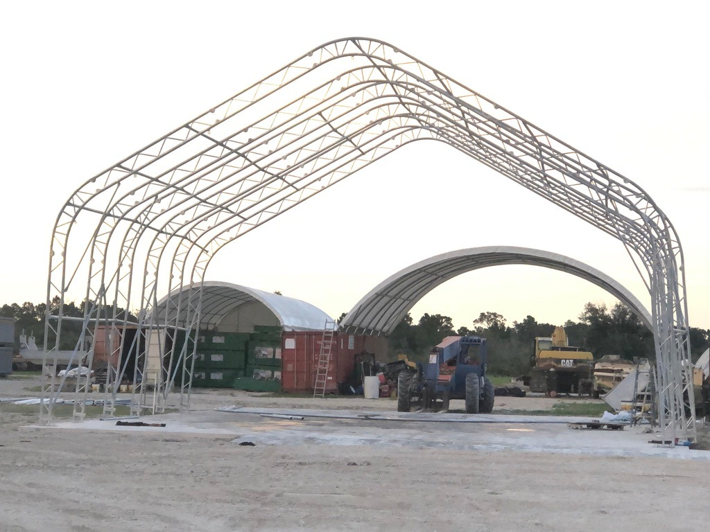 Structure for fabric shelter