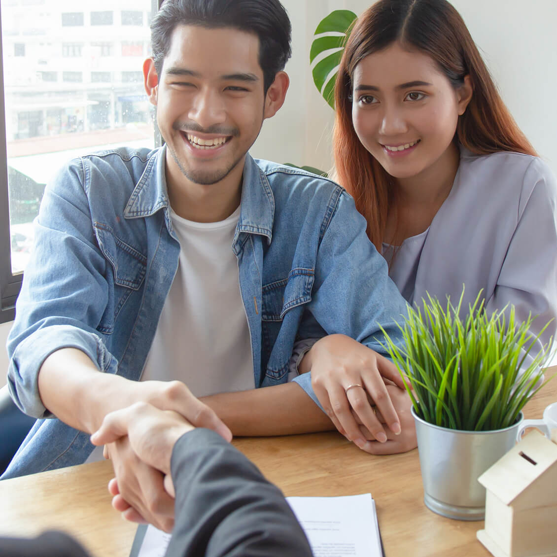 Couple Completing Mortgage Application