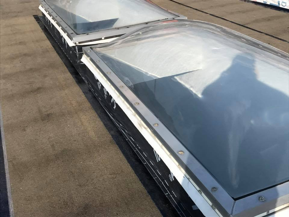 Flat-roof-skylight_flashing-Statewide-Construction_and_Roofing