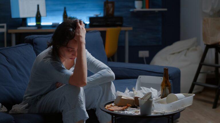 Frustrated stressed woman having headache feeling sad depressed